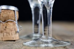Cork from champagne on a wooden kitchen table. Good New Year's d. Rinks and great fun. Dark background Stock Photo