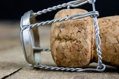 Cork from champagne on a wooden kitchen table. Good New Year's d. Rinks and great fun. Dark background Stock Image