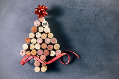 2018 Cork Christmas tree and star. A Christmas tree made of wine bottle corks featuring the year 2018 with red ribbon and star  with copy space on a dark Royalty Free Stock Photo