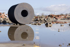 Cork cilinder. Abandoned waste material. Rain water reflexions on a background devasted Stock Photos