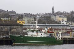 Cork City Harbour Ireland The Marine Institute research vessel Celtic Voyager on her berth during a late winter snow storm royalty free stock photography