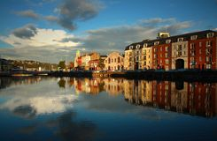 Cork, Ireland. Cork city reflected in the river Lee at twilight Stock Photos