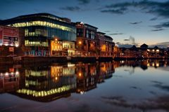 Cork city reflection at dusk. Illuminated buildings in Cork city, Ireland Royalty Free Stock Images