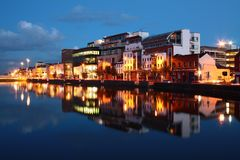 Cork city reflection at dusk. Illuminated buildings in Cork city, Ireland Stock Photo