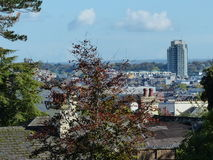 Cork city skyline Ireland. With trees in the foreground Royalty Free Stock Images