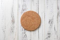 Free Cork Coaster On White Wooden Background Stock Image - 103941031