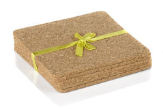 Cork coasters under glasses Stock Image