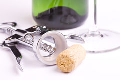 Cork, corkscrew, bottle of wine and glass Stock Image