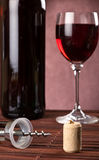 Cork and corkscrew with bottle and wine glass Stock Image