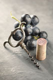 Cork, corkscrew and red grapes Royalty Free Stock Photo