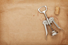 Cork and corkscrew with red wine stains Stock Image
