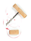 Cork and corkscrew with red wine stains. Isolated on white background Stock Image