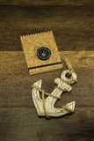 Cork cover book with compass and large old white anchor Stock Photo