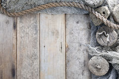 Cork, fishing net and rope. With wooden background royalty free stock photos