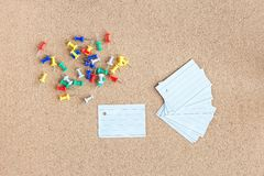Cork memory board with blank peaces of paper and heap of pins horizontal. Cork memory board with blank peaces of paper and heap of pins, horizontal royalty free stock photography