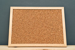 Cork memory board on wooden cabinet Royalty Free Stock Photo