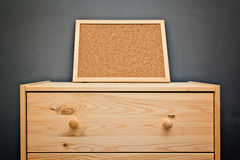 Cork memory board on wooden cabinet Stock Images