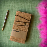 Cork notebook on fabric background Stock Photos