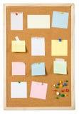 Cork notice board. Blank sticky notess pinned on cork notice board Stock Image
