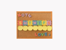 A cork notice board with empty post it for everyday in a week with starting text of day. And love word at the bottom of board Royalty Free Stock Image