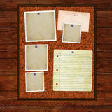 Cork notice board on wooden background Stock Images