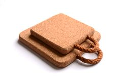 Cork pads for hot kitchen utensils on a white background stock image