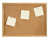 Cork raad met hanger en drie bulletins. Stock Fotografie