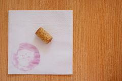 Cork and red wine stain. On white napkin Royalty Free Stock Photography