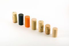 Cork row. A variety of different wine cork standing arranged in a row Royalty Free Stock Images