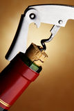 Cork-screw opening wine bottle. Over dark background Stock Image