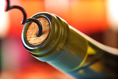 Cork screw and wine bottle Royalty Free Stock Images