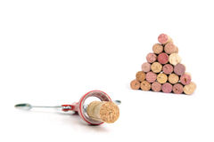 Cork screw and wine corks. Cork screw and wine cork pyramid over white background Stock Photos