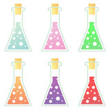 Cork sealed lab bottles set. Colorful lab bottles filed with bubbles and sealed with a cork Stock Photos