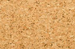 Cork sheet surface with fine texture, macro photo. Cork sheet surface with fine texture, comprised of small grained cork oak, Quercus suber. Decorative panels Royalty Free Stock Image