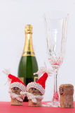 Cork and sparkling wine. Sympathetic corks with Christmas hat to toast the new year Stock Photography