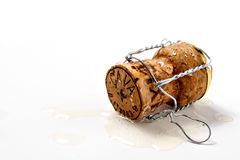 Cork in spilled champagne Royalty Free Stock Images