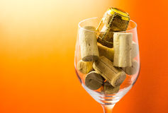 Cork stoppers in wine glass Royalty Free Stock Images