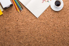 Cork table. Topview of cork table with blank notepad, coffee cup, pencils and other items. Mock up Royalty Free Stock Photos