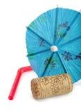 Cork, umbrella and straw. WIne cork,paper umbrella and drinking straw straw isolated on white Stock Photo