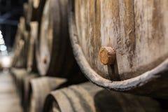 Cork of a wooden porto wine barrel in wine cellar of Porto. Portugal royalty free stock photography