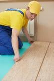 Cork worker at flooring work Royalty Free Stock Image