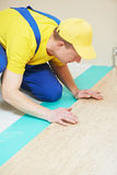 Cork worker at flooring work Royalty Free Stock Image