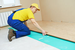 Cork worker at flooring work Royalty Free Stock Photos