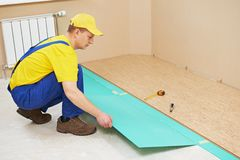 Cork worker at flooring work Royalty Free Stock Photography