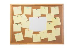 Corkboard and blank paper notes. Stock Images