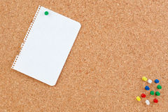 Corkboard with blank paper punch Stock Photos