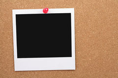 Corkboard and blank photo Royalty Free Stock Photography