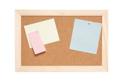 Corkboard with empty blue pink and yellow notes Royalty Free Stock Photo