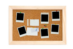 Corkboard with empty frame and notes. On isolated stock image
