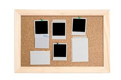 Corkboard with empty frame and notes Stock Photos